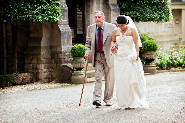 bride and grandfather walking at Hambleton Hall