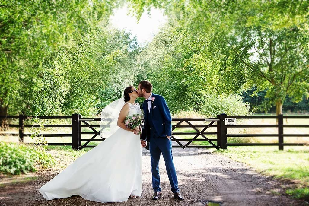 bride and groom kissing at Cockcliffe Country House