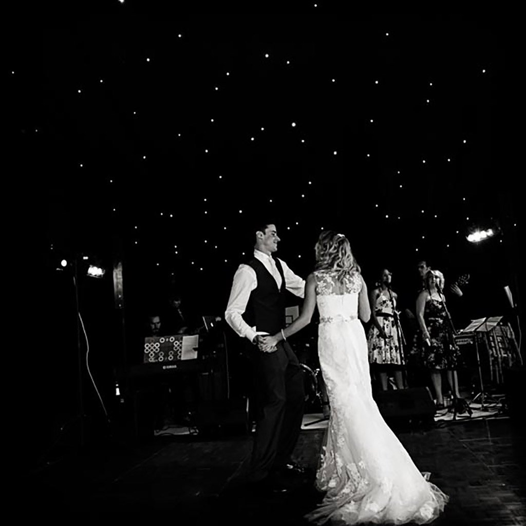 bride and groom's first dance in marquee wedding
