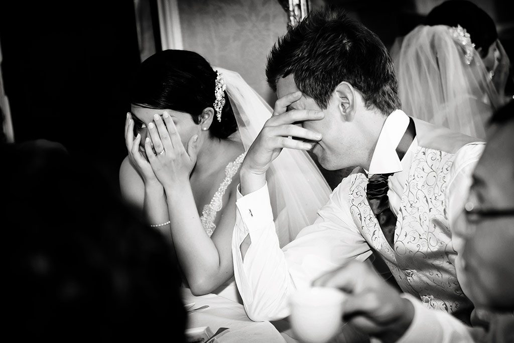 embarrassed bride and groom during speeches at Hambleton Hall