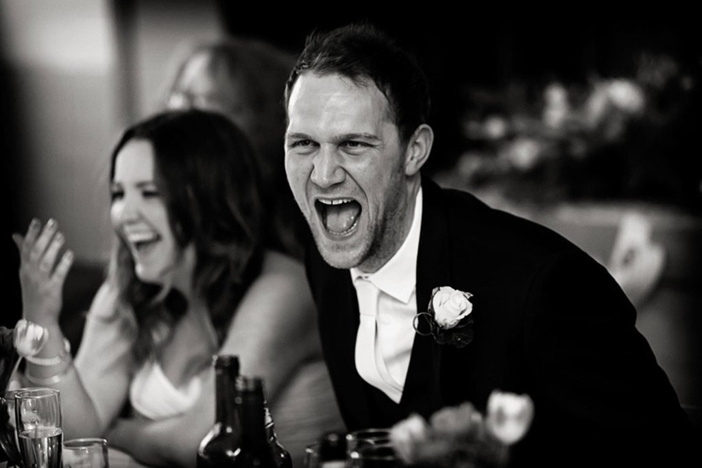 groom laughing at nottingham wedding