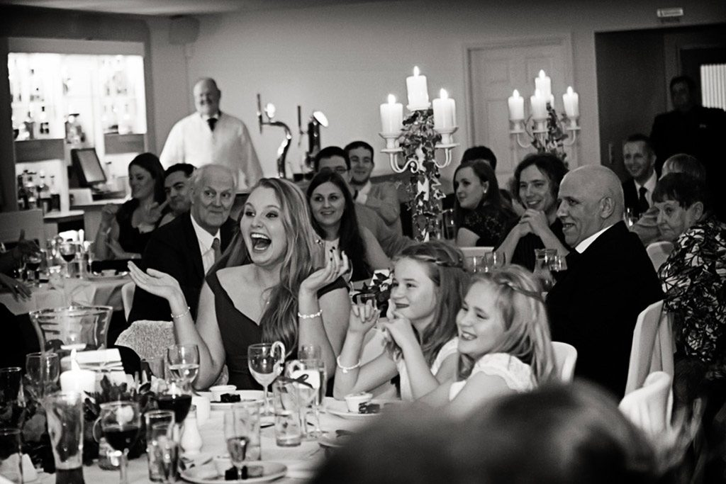 wedding guests laughing during speeches at Kelham House