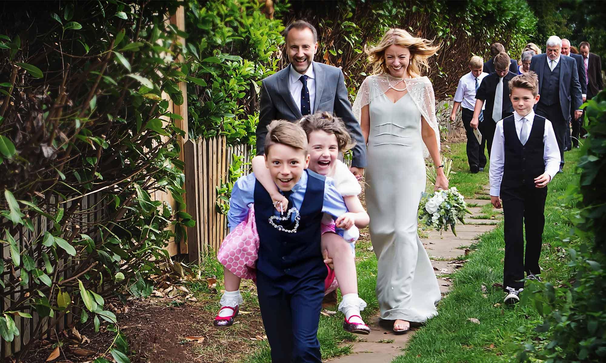 bride groom and children walking from Nottingham wedding church
