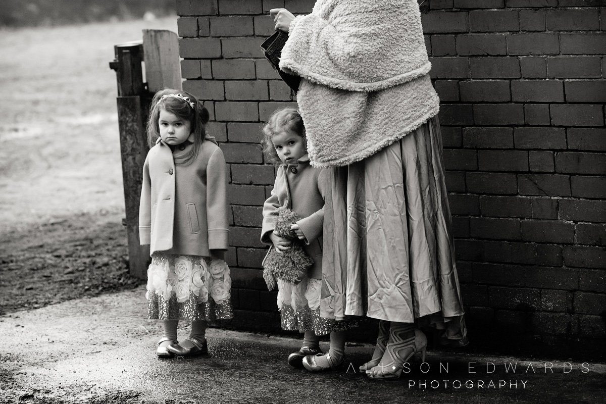 bridesmaids waiting outside of church