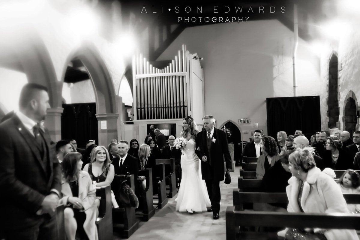 bride and father walking into draycott church wedding