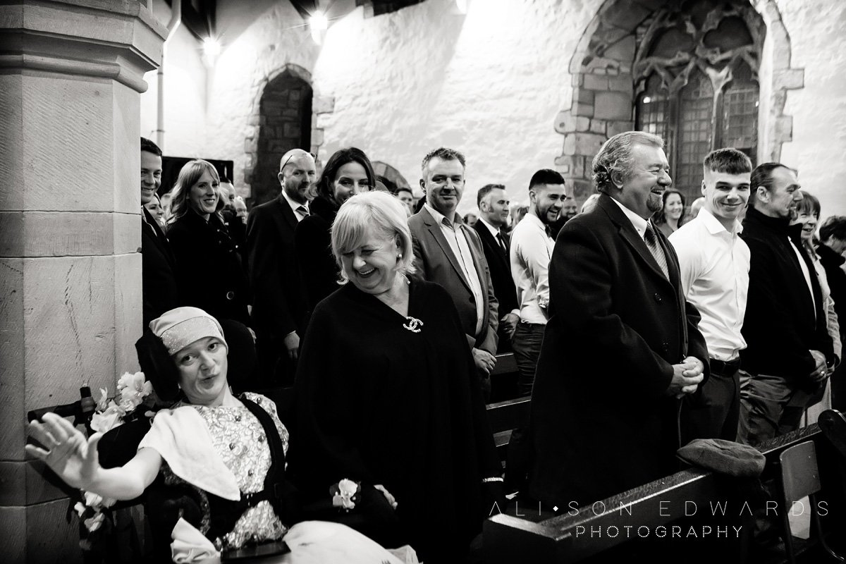 wedding guests laughing in church