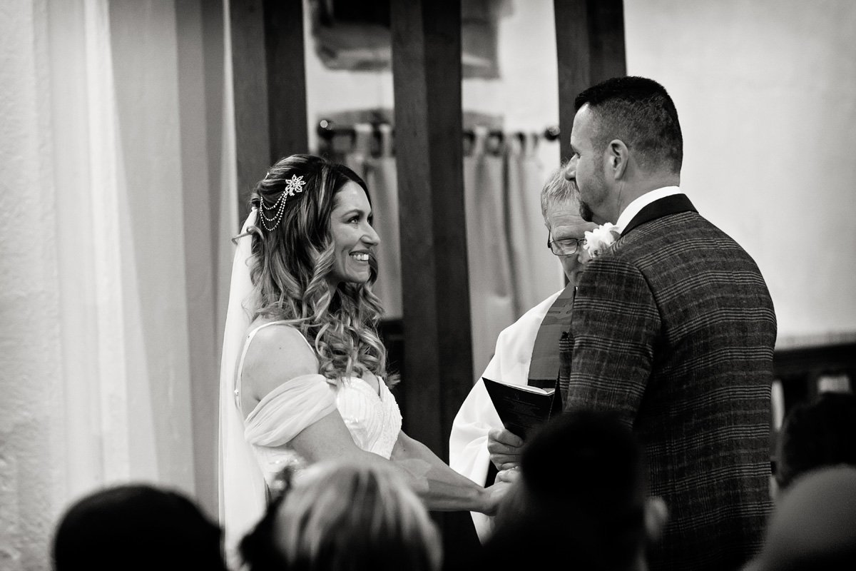 bride smiling at groom in draycott church wedding