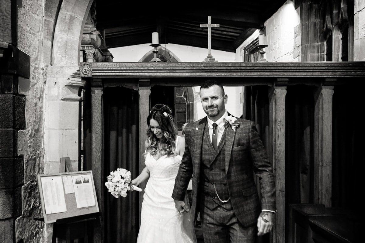 bride and groom after signing register