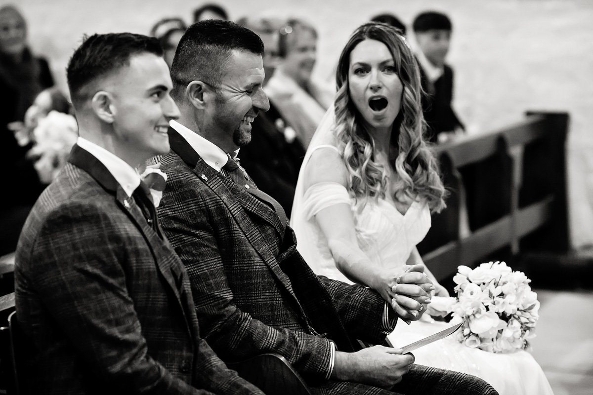 bride's surprised expression draycott church wedding