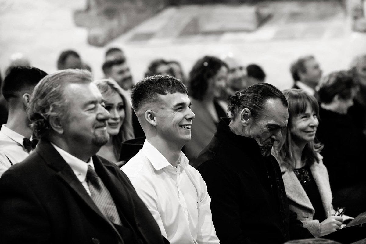 wedding guests laughing in derby church