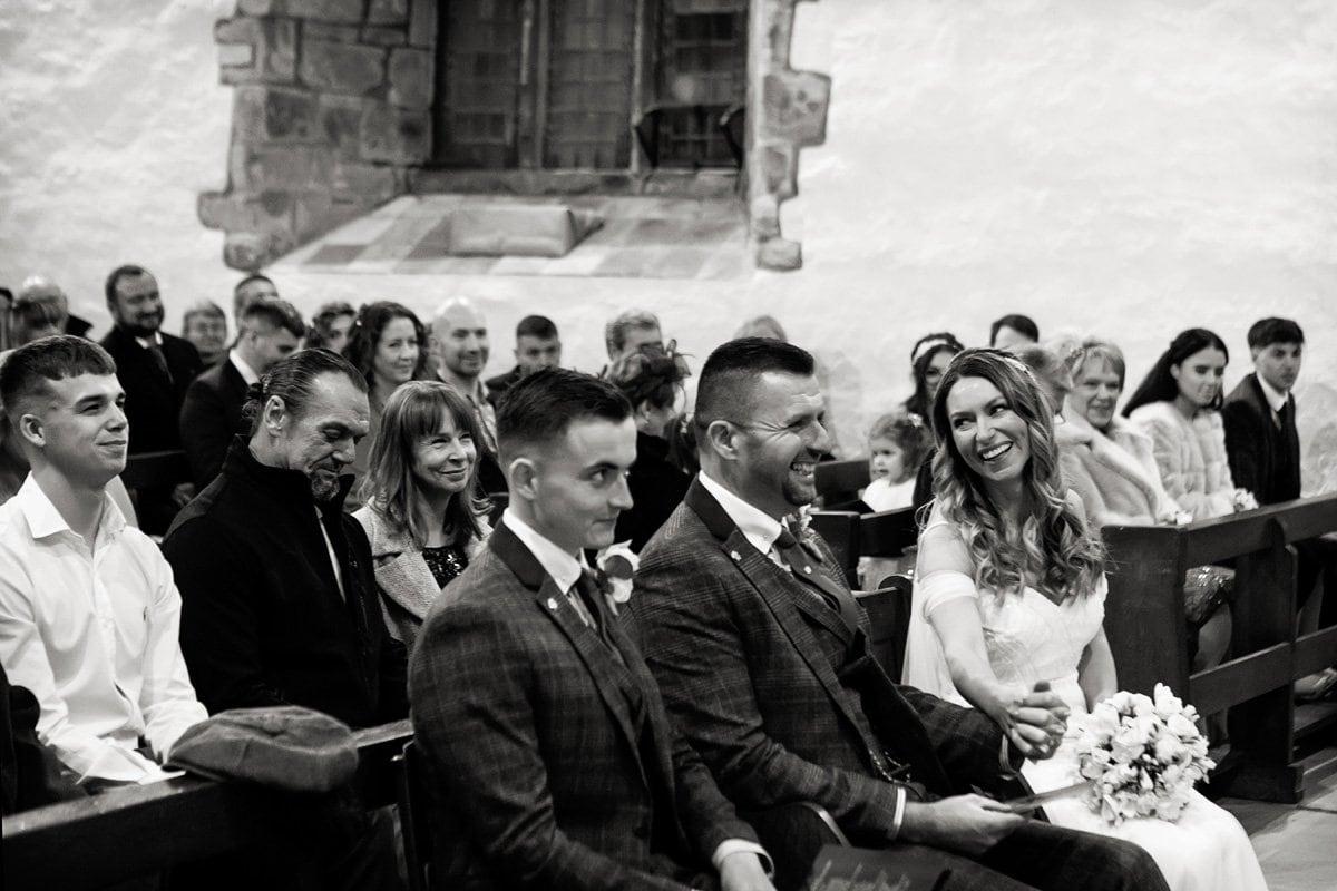 bride and groom laughing draycott church wedding