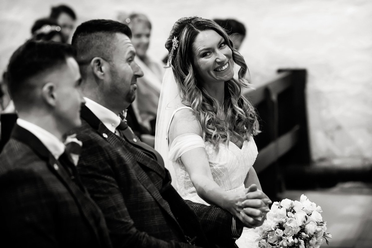 bride laughing in derby church
