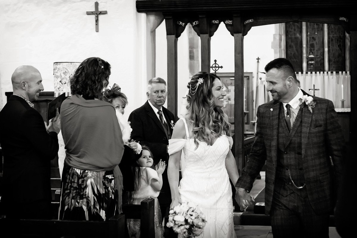 bride and groom walking out of draycott church wedding