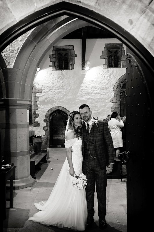 bride and groom in church entrance