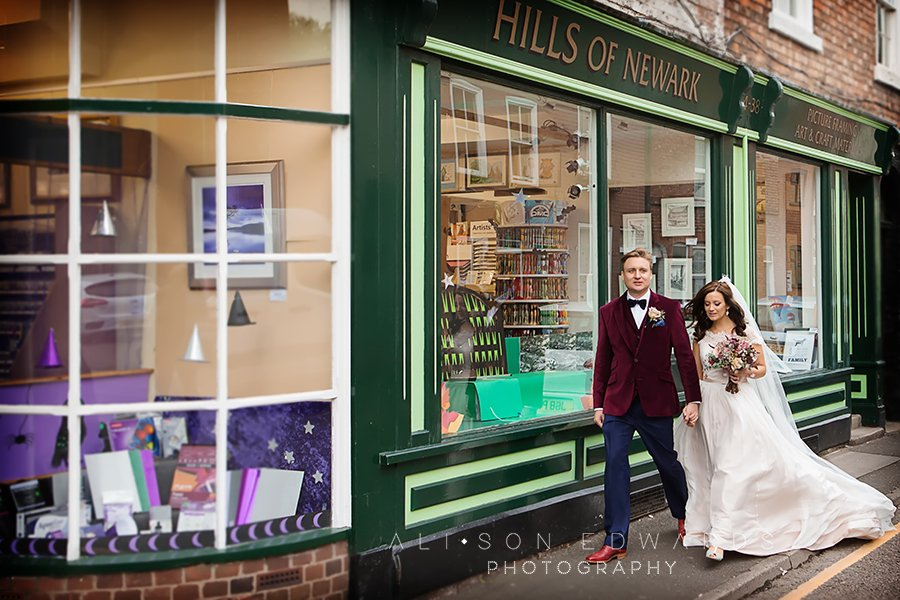 cool bride and groom walking through Newark town centre