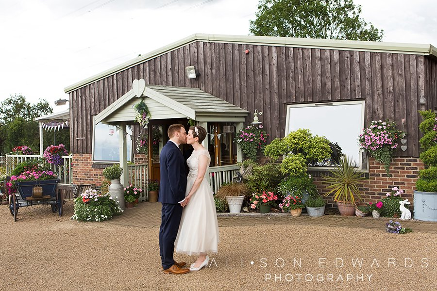 bride and groom kissing floral media short coverage wedding photography