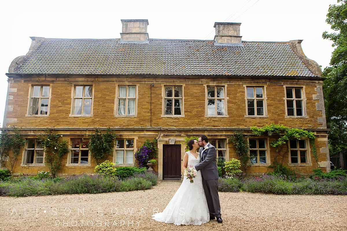 bride and groom kissing at allington manor