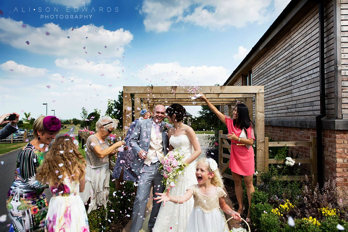 bride and groom confetti shot at Mythe Barn