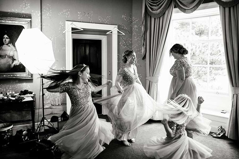 intimate wedding photography of bridesmaids dancing