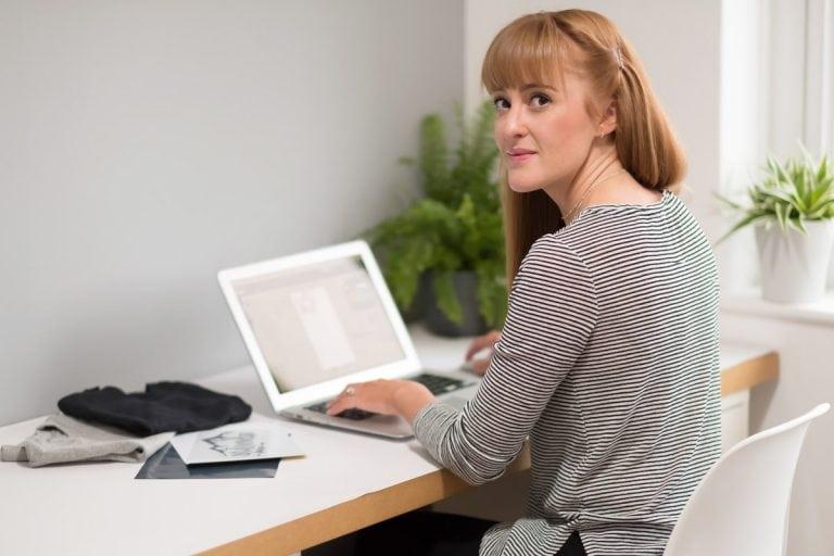 business woman on computer on branding shoot