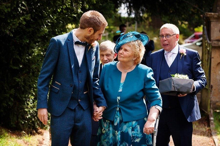 groom walking grandparents into  church Nottingham wedding photographer