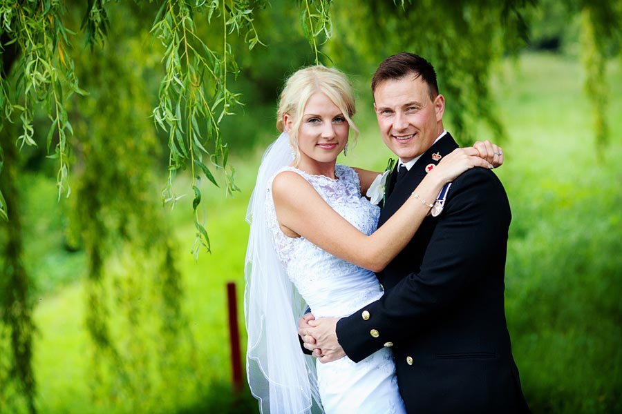 bride and groom in navy uniform