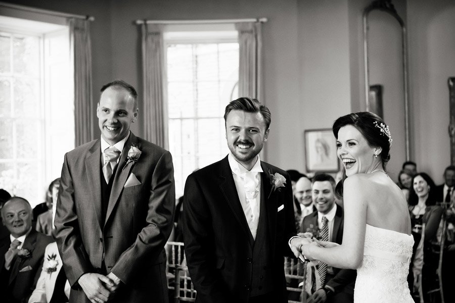 bride and groom laughing at alter norwood park Nottingham wedding photographer