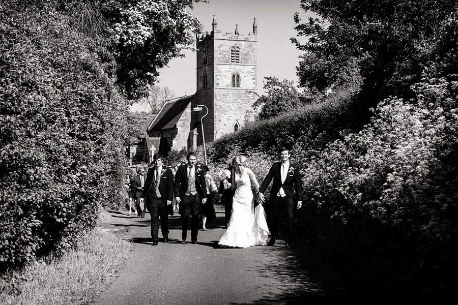 Nottingham wedding photographer bride groom and guests walking from church