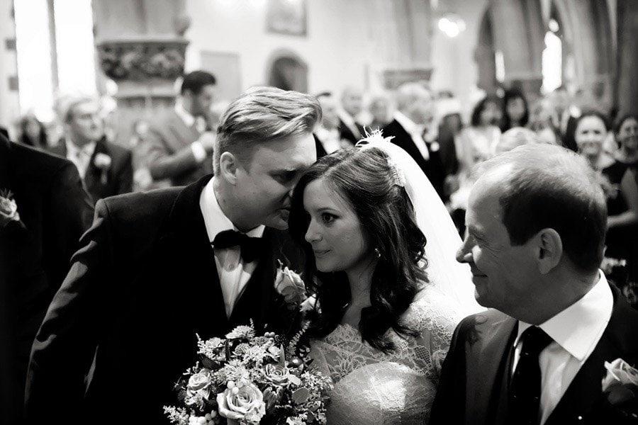 bride and groom in church Nottingham wedding photographer