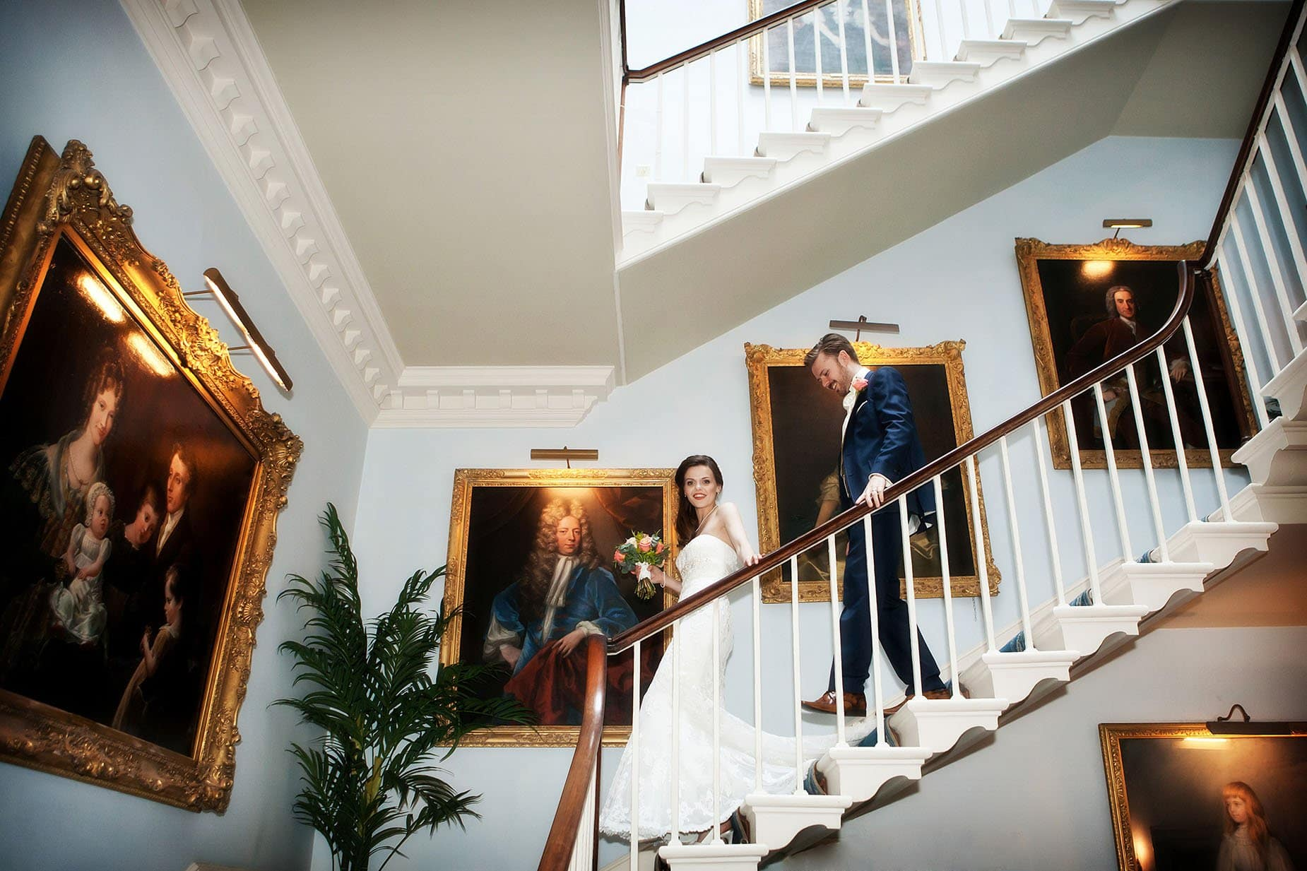 bride and groom on stairs at norwood park east midlands wedding venues