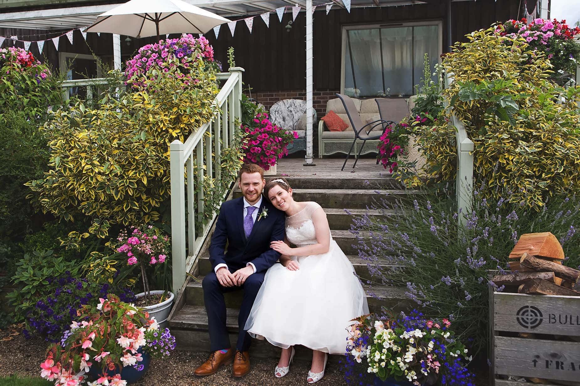 bride and groom on steps at floral media east midlands wedding venues