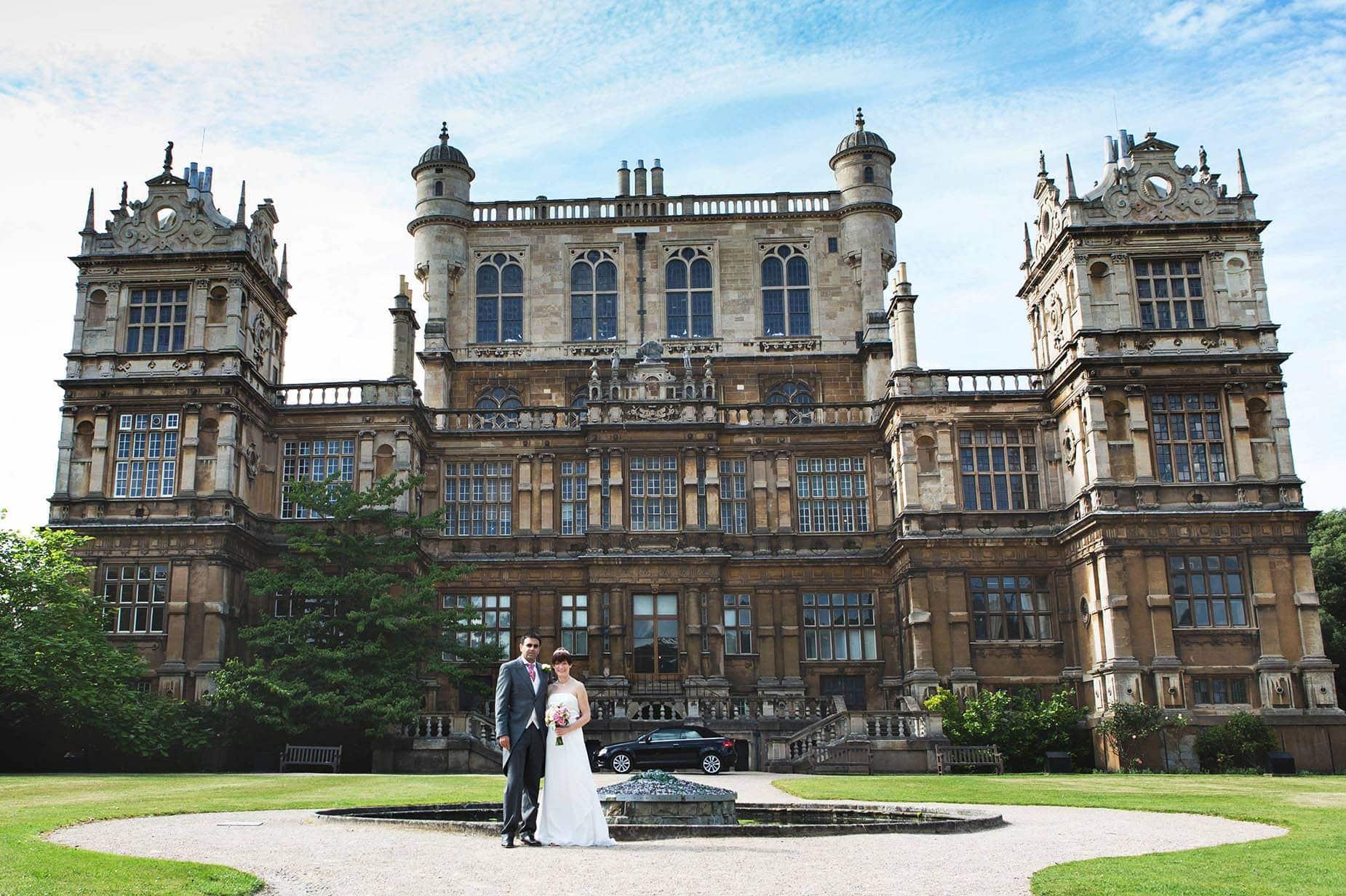 bride and groom at wollaton hall east midlands wedding venues