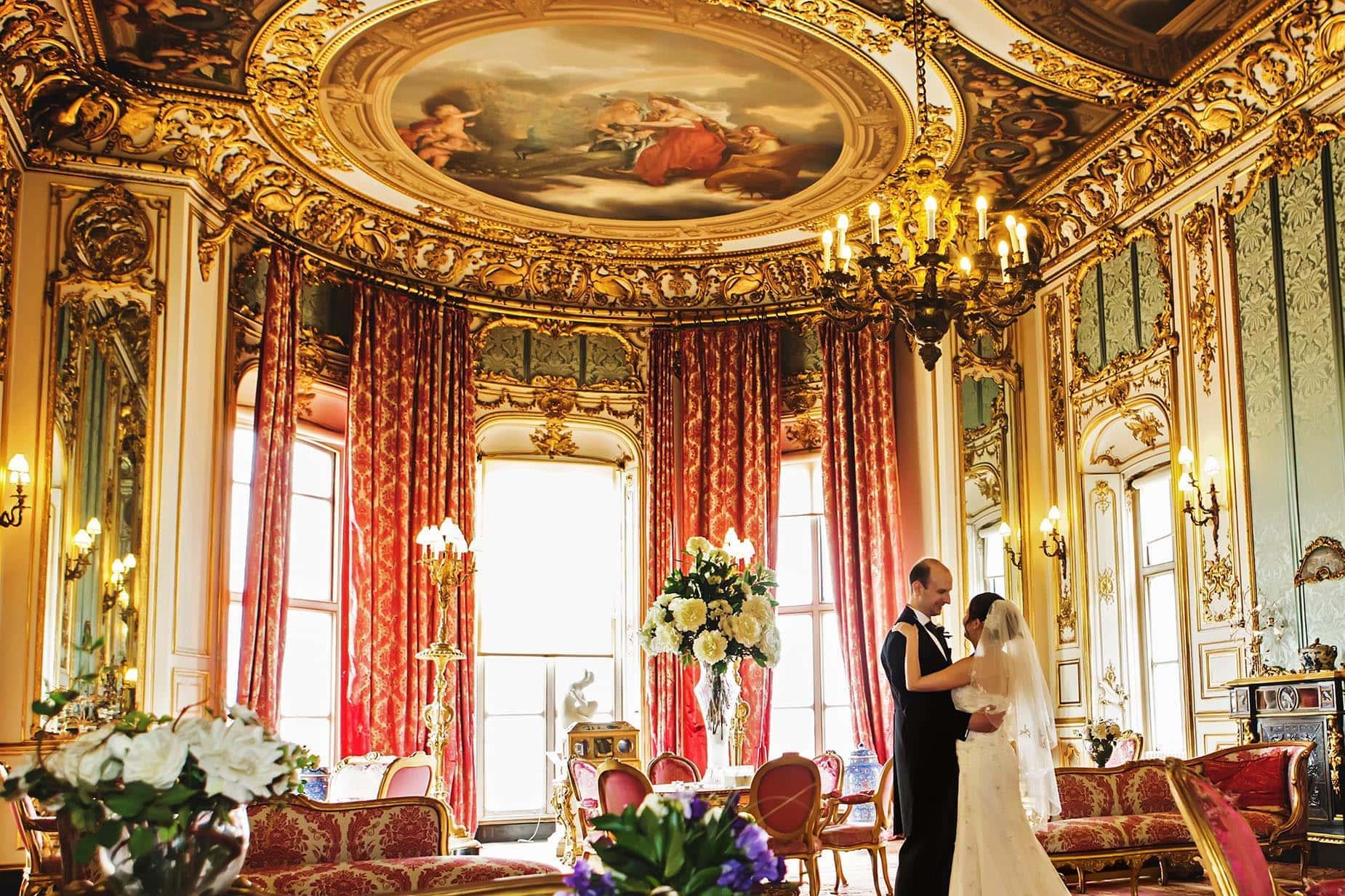 bride and groom dancing pink room at belvoir castle