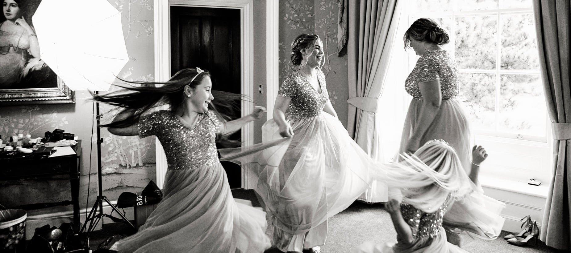 bridesmaids dancing at stubton hall wedding natural wedding photography