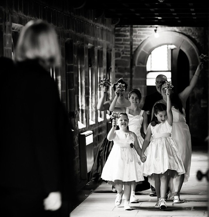 bridesmaids cheering walking into ceremony at newstead abbey