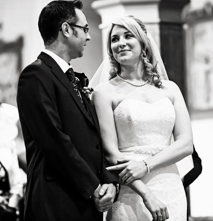 natural wedding photography of bride and groom at church alter