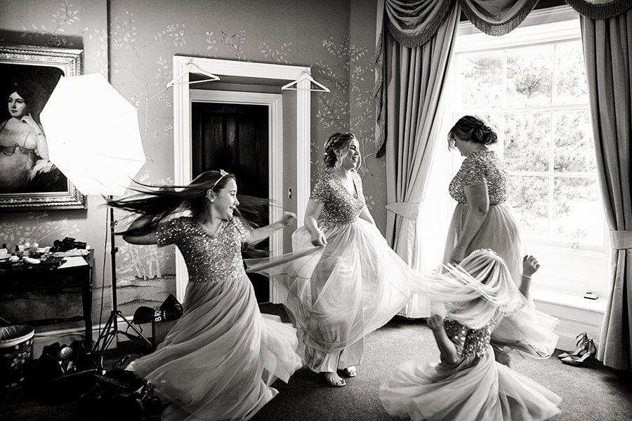 bridesmaids spinning around at Stubton Hall wedding