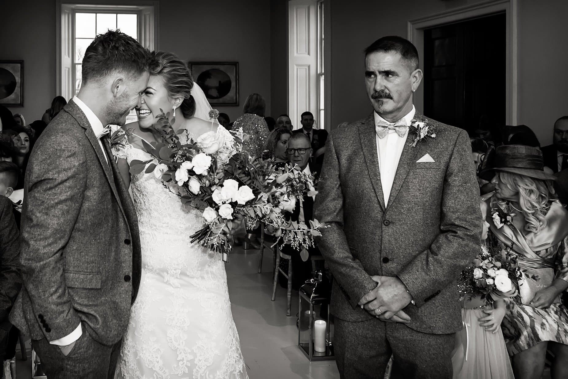 bride and groom smiling at alter at nottinghamshire wedding