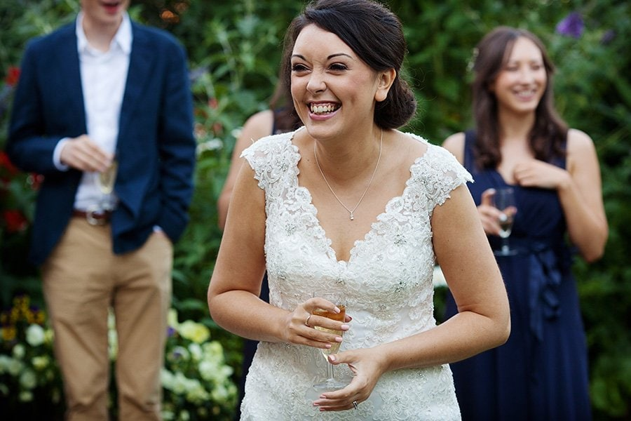 bride laughing at speeches in nottinghamshire wedding