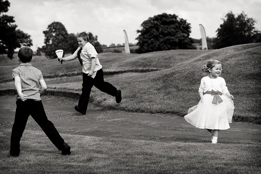Nottingham wedding photographer children playing on golf course at The Nottinghamshire