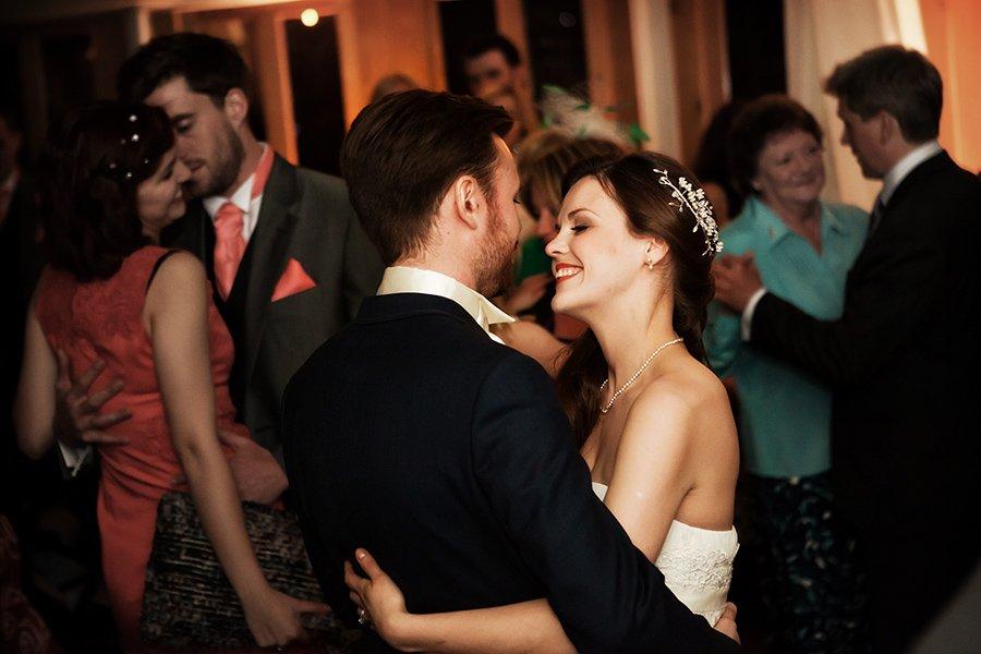 uk wedding photographer bride and groom dancing at norwood park