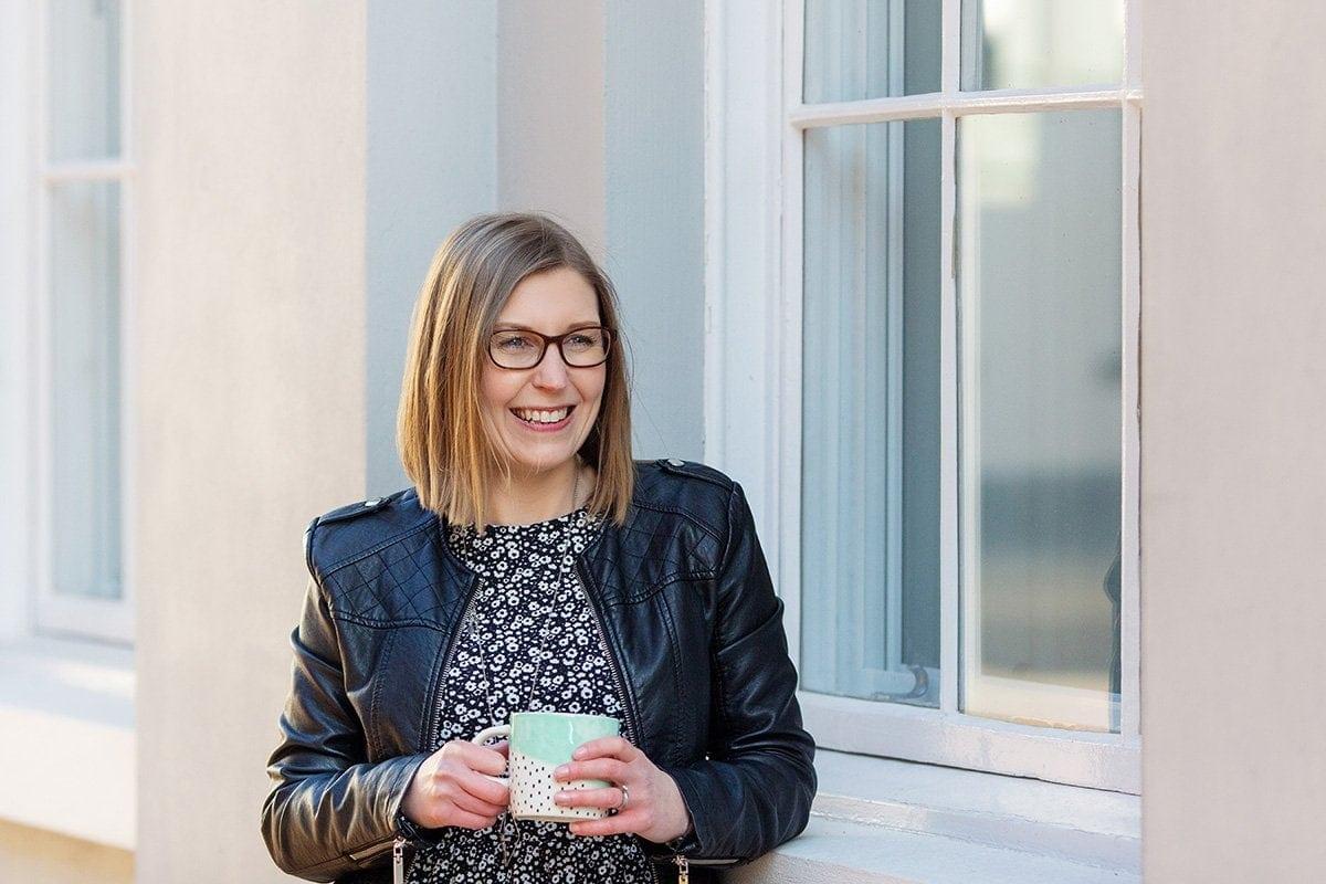 creative entrepreneur on business photo shoot drinking coffee