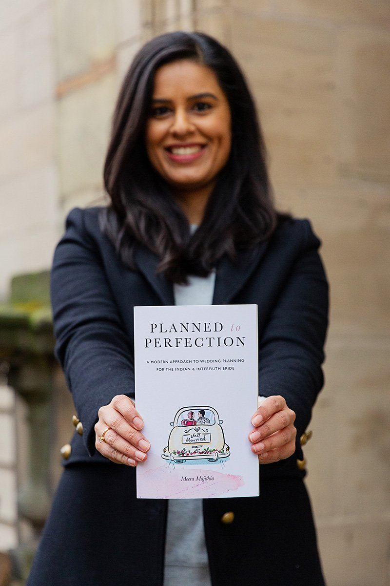 wedding planner showing her published book on branding shoot