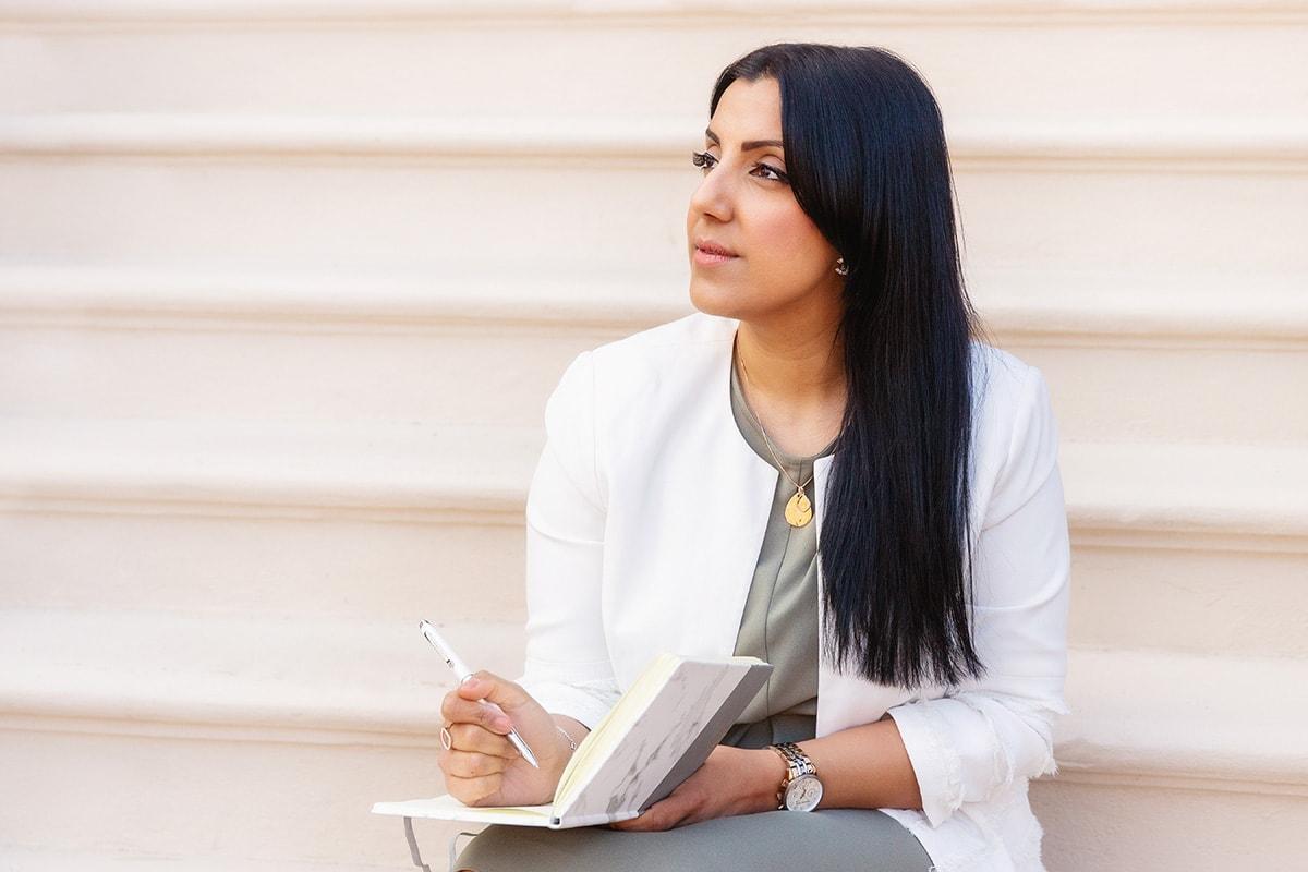 entrepreneur writing in notebook on branding shoot