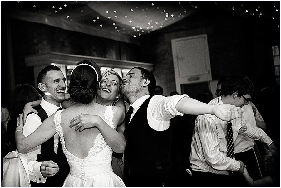 relaxed wedding photography bride and groom dancing with guests
