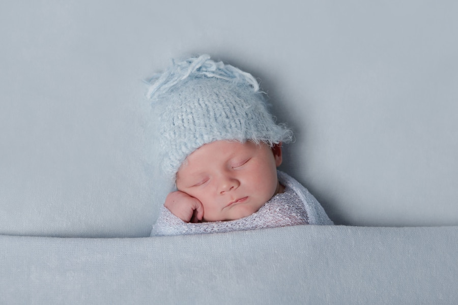 newborn boy on blue blanket