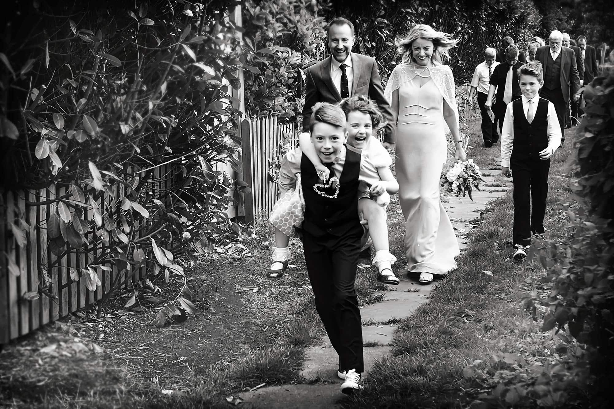bride and groom walking with guests from nottingham church