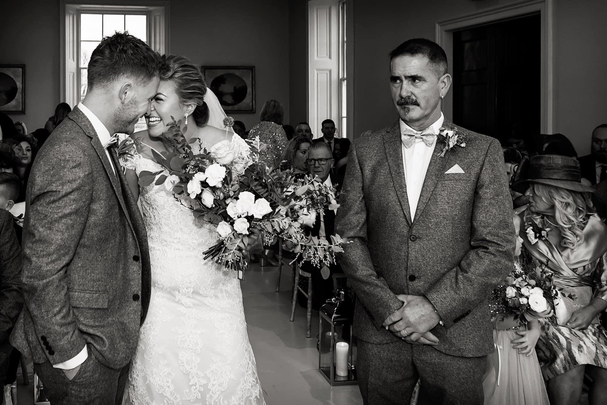 bride and groom laughing at stubton hall Nottingham wedding photographer