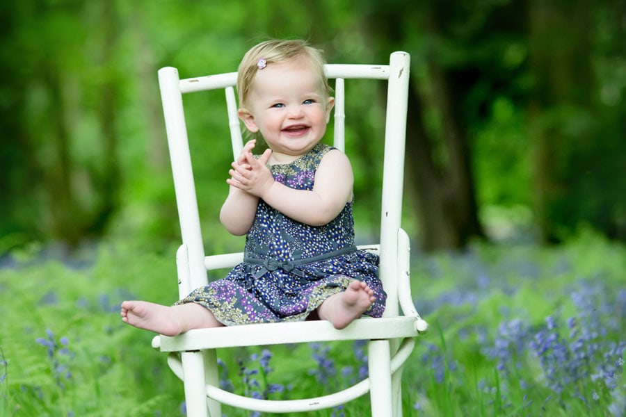 family photography nottingham baby girl sitting on chair in bluebell woods