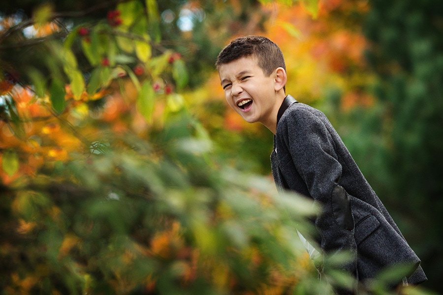 young boy laughing on autumn photo shoot nottingham family photography